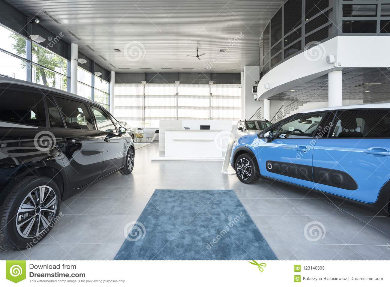 Modern Elegant Car Showroom Interior With Two Blue And Black Cars