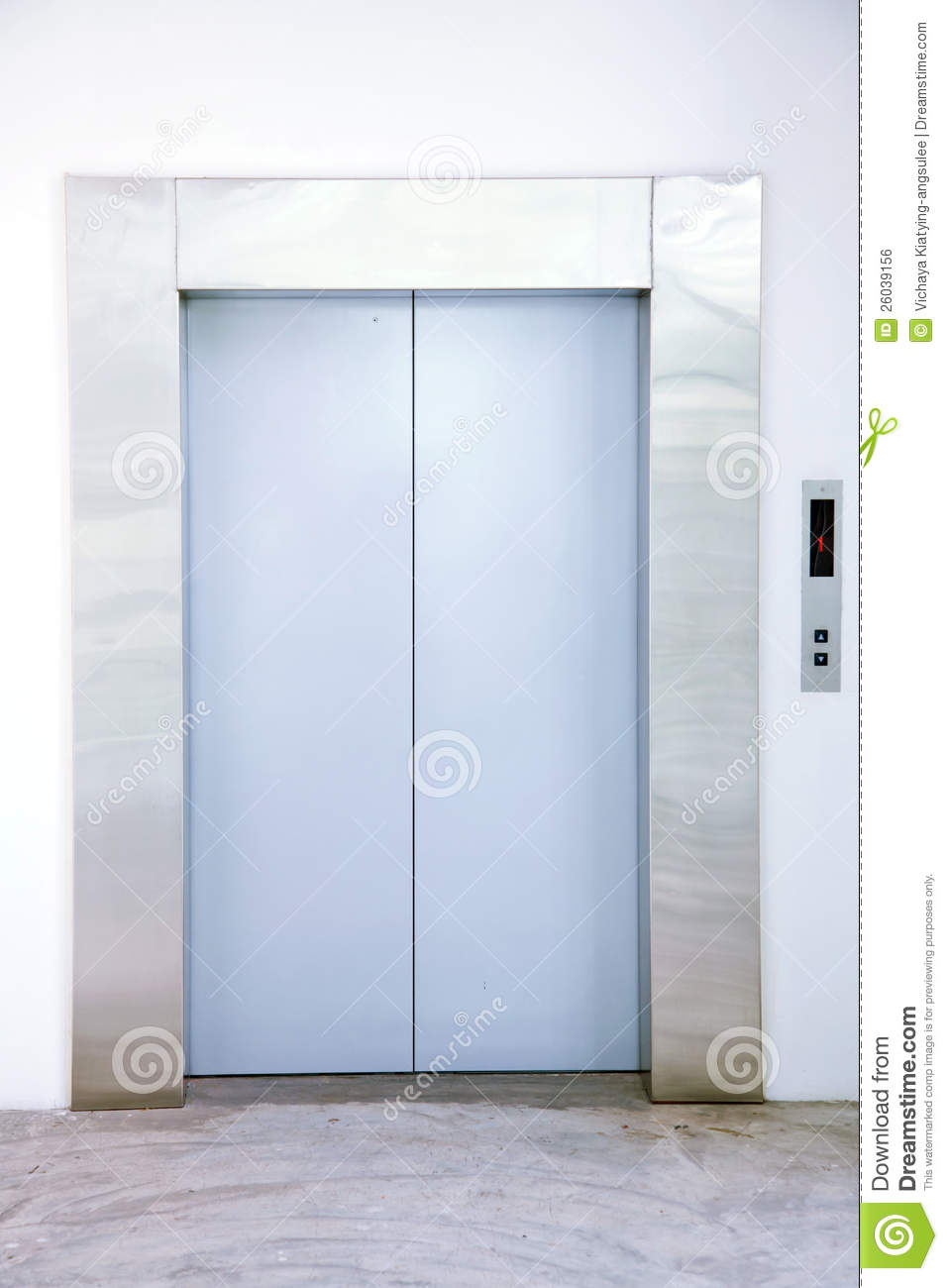 Front view of a modern elevator with closed doors in lobby.