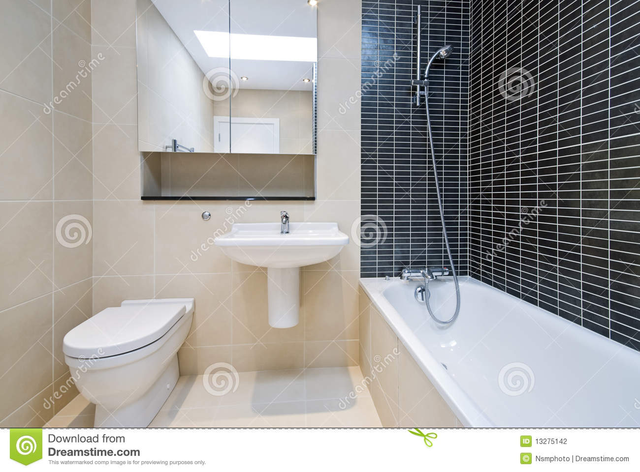 Modern En Suite Bathroom In Beige With Black Tiles Stock
