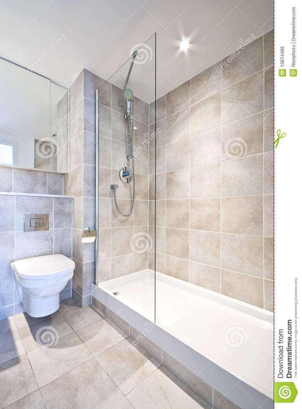 Modern en suite bathroom with large shower royalty free for Chambre salle de bain combles