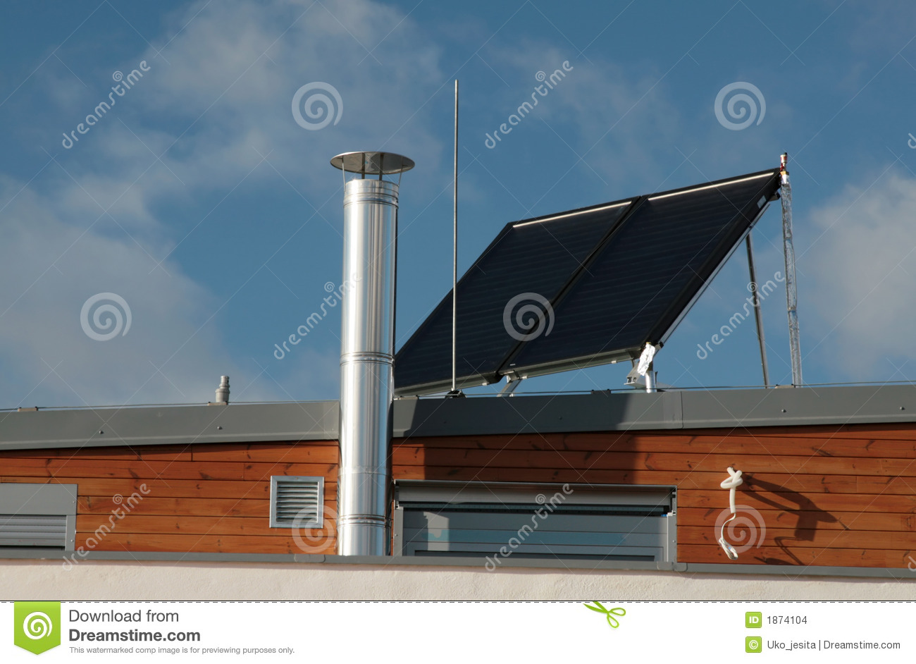 Modern Family House With Solar Panels On The Roof Stock