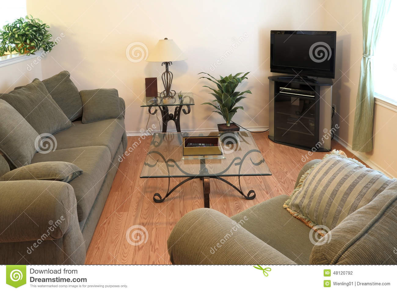Family in living room with young girl kissing woma stock for Family in the living room