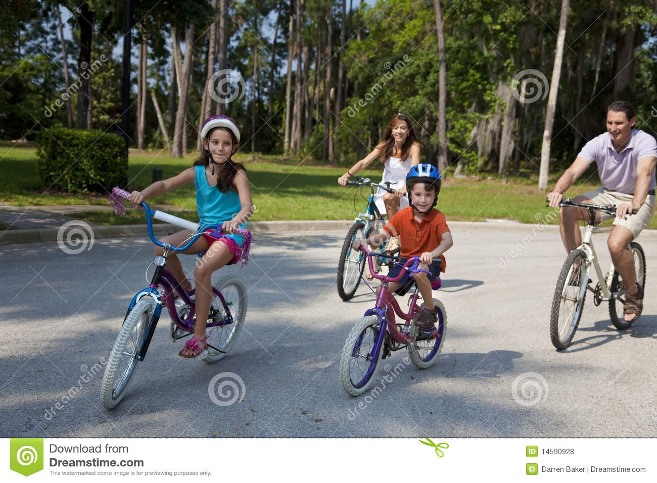 Modern Family Parents And Children Cycling Stock Photo ...