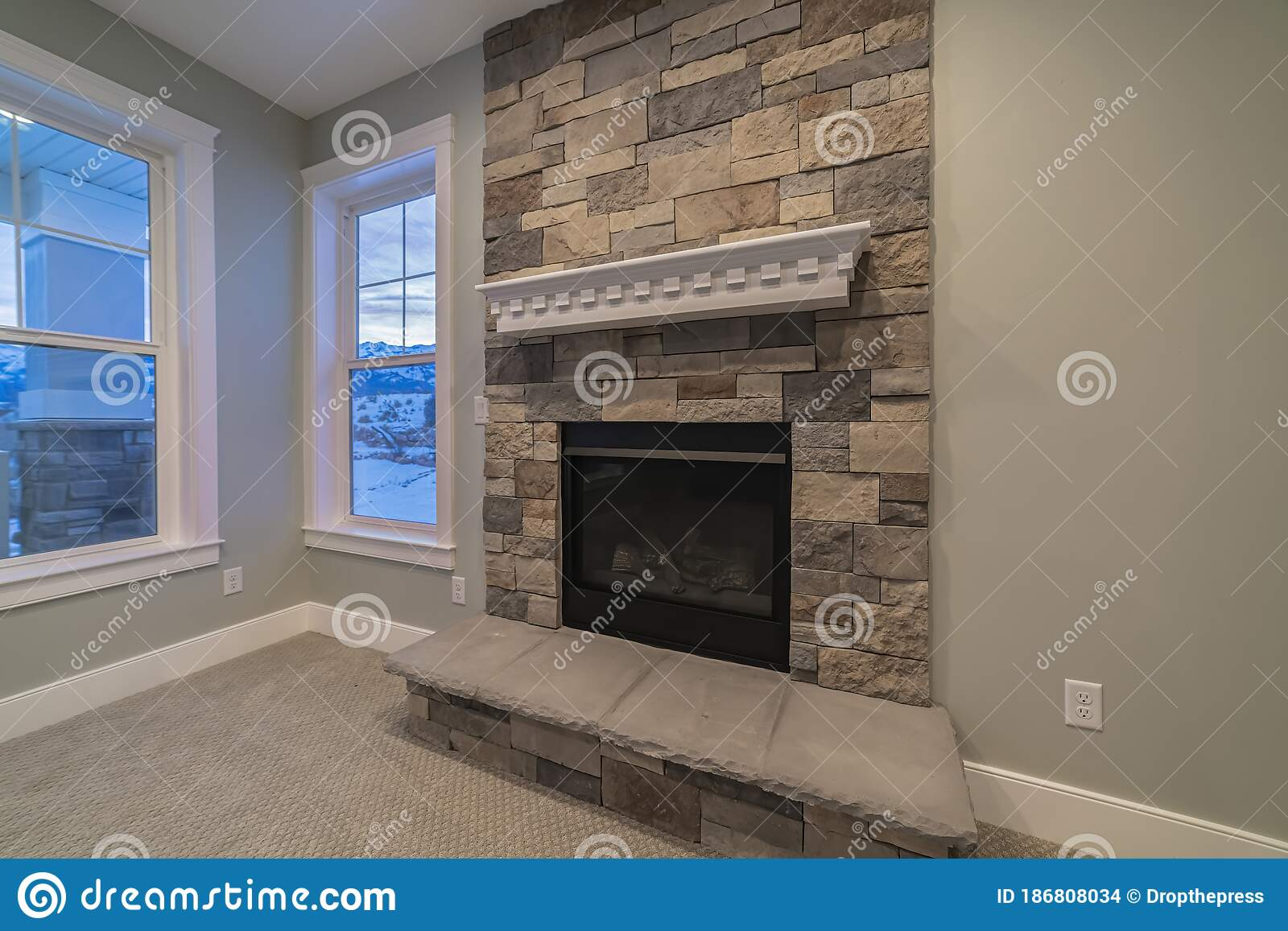 Picture of: Modern Fireplace And Decorative Shelf Against Stone Brick Accent Wall Of Home Stock Photo Image Of Brick Outdoors 186808034