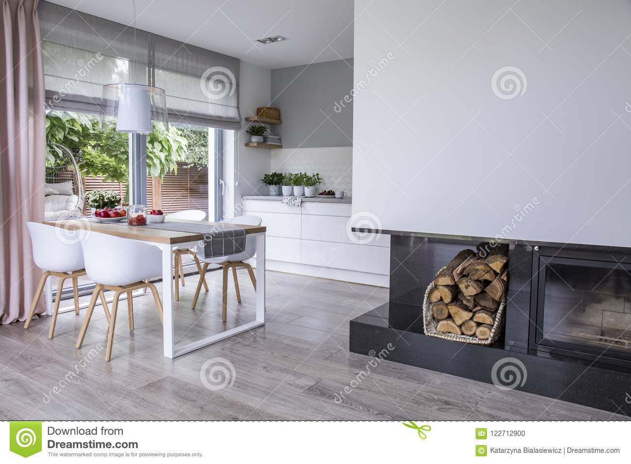 Modern Interieur Wit : Modern fireplace and wood in a spacious dining room interior wit