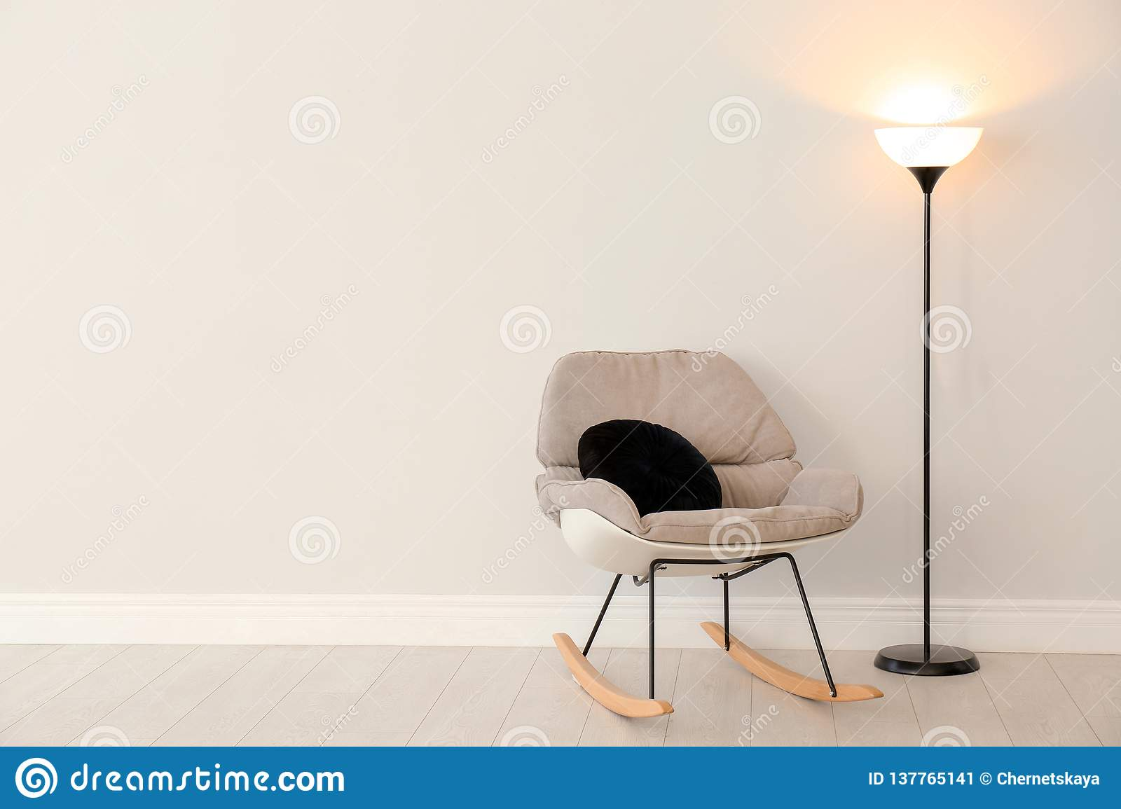 Fabulous Modern Floor Lamp And Rocking Chair Against Light Wall Ibusinesslaw Wood Chair Design Ideas Ibusinesslaworg