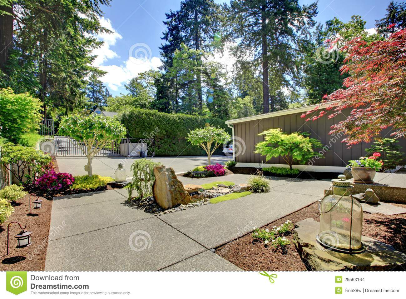 Modern front yard landscape with walkways and rocks stock for Domestic garden ideas