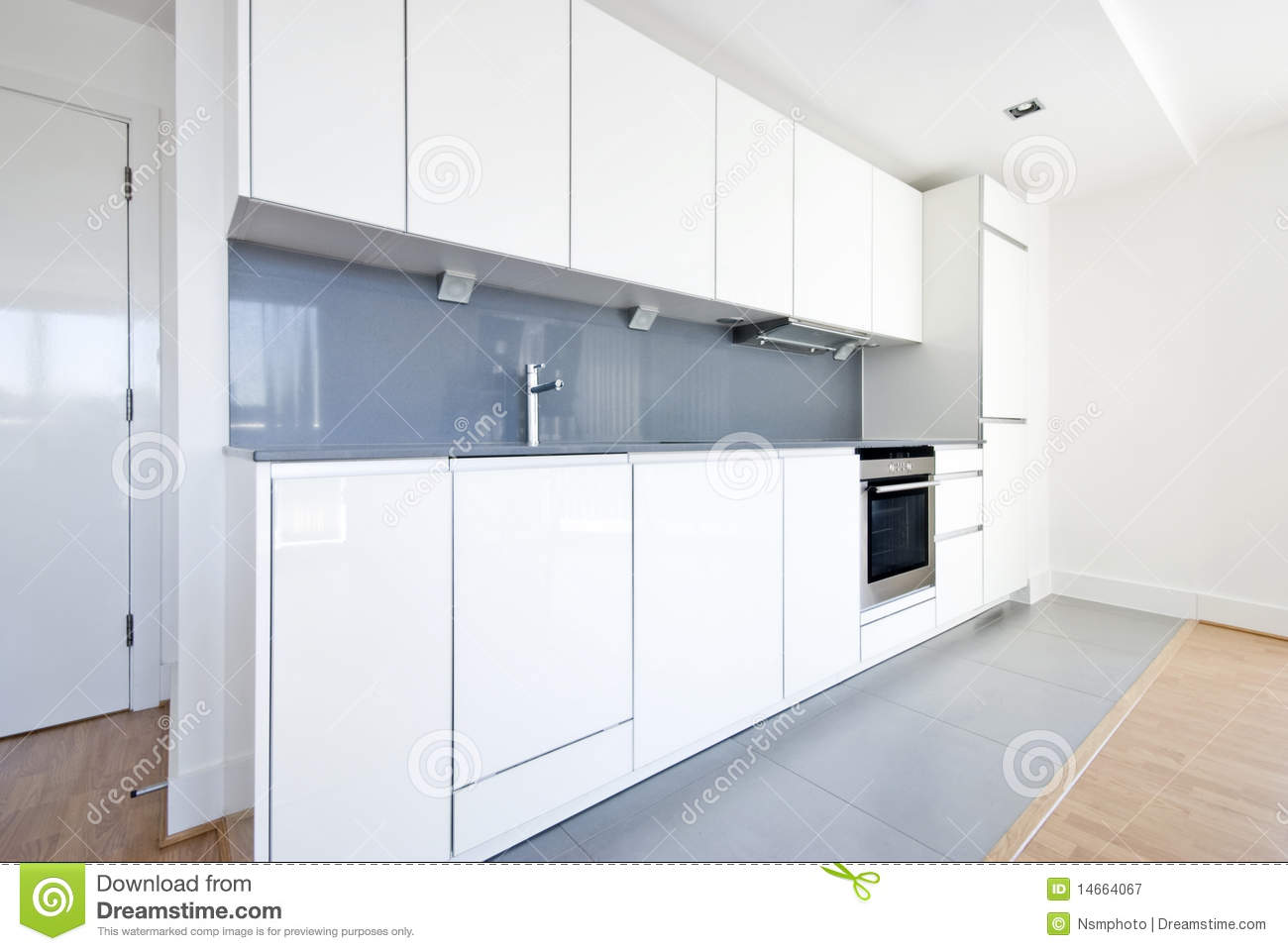 Modern Fully Fitted Kitchen In White And Gray Royalty Free Stock