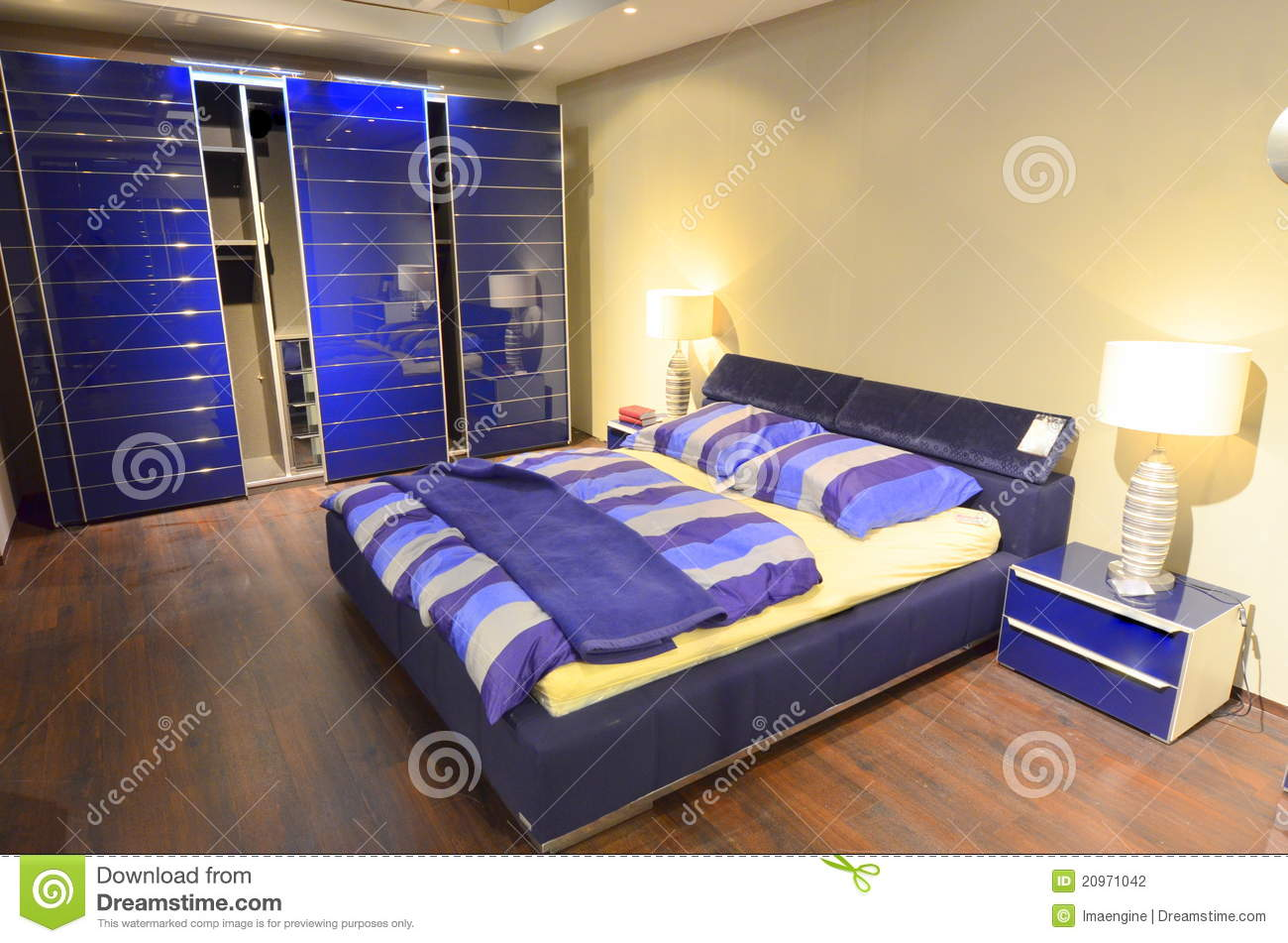 Spacious sleeping area royalty free stock photography Modern bedroom blue