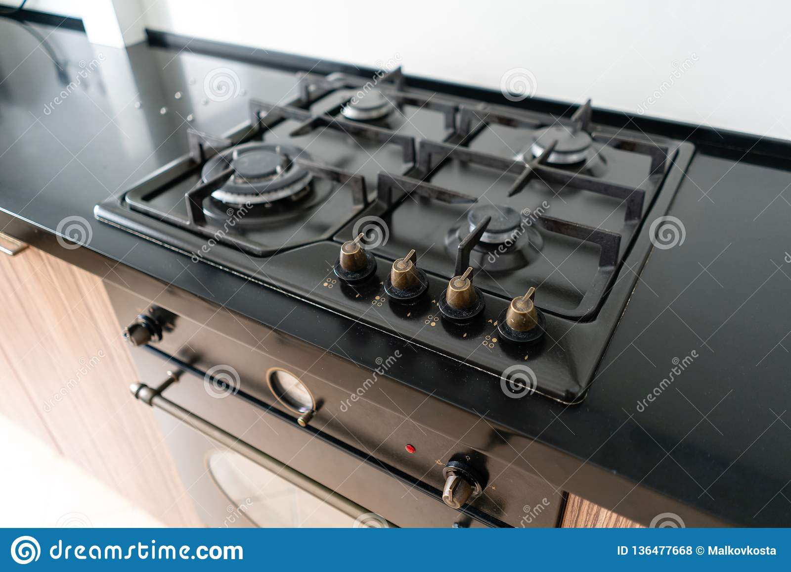 Modern Gas Burner And Hob On A Kitchen Range. Dark Black ...