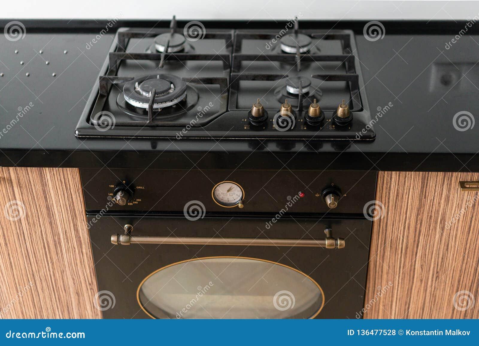 Modern Gas Burner And Hob On A Kitchen Range, Oven. Dark ...