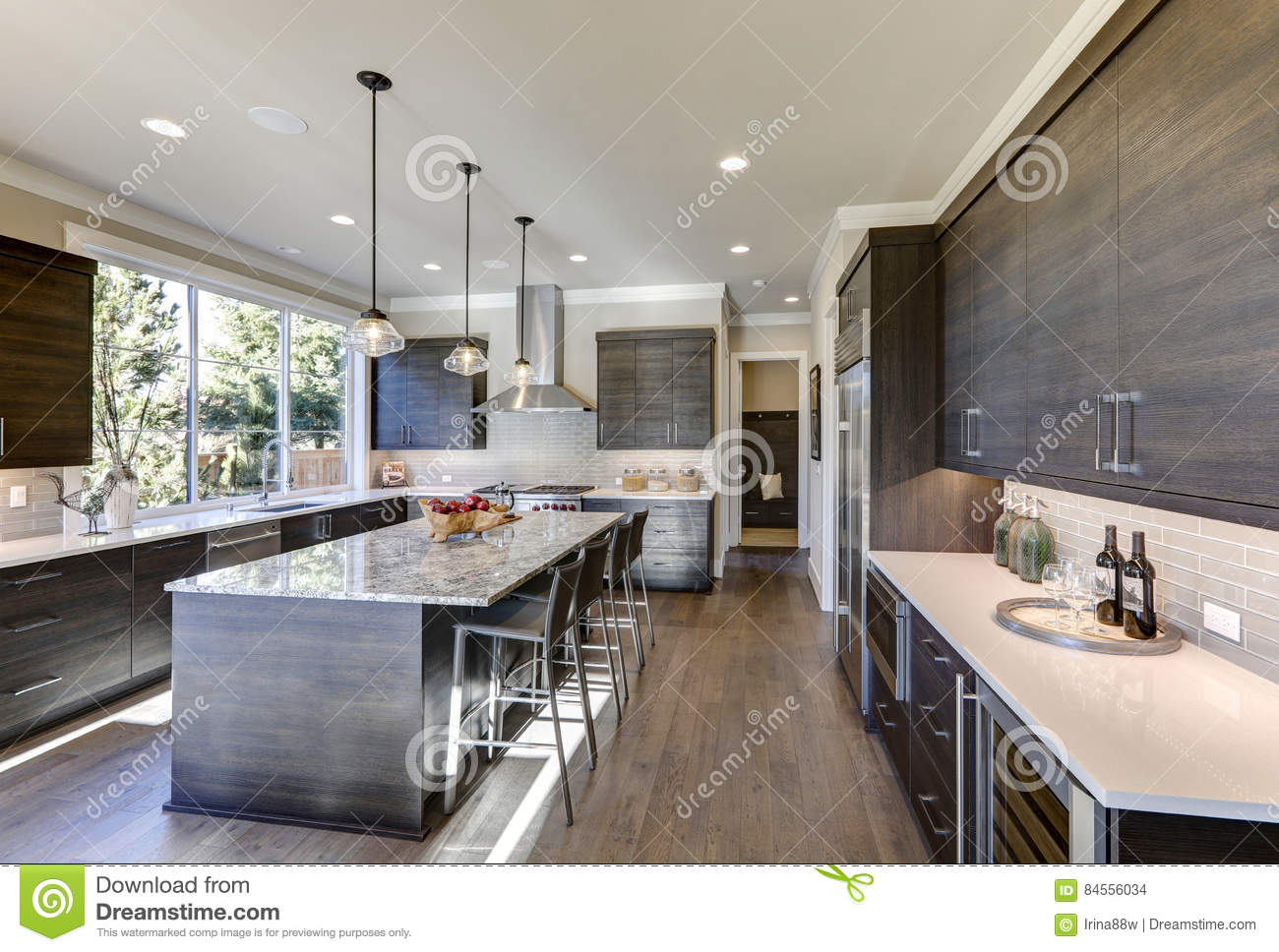 Modern Gray Kitchen Features Dark Gray Flat Front Cabinets Stock Photo Image Of Kitchen Elegant 84556034
