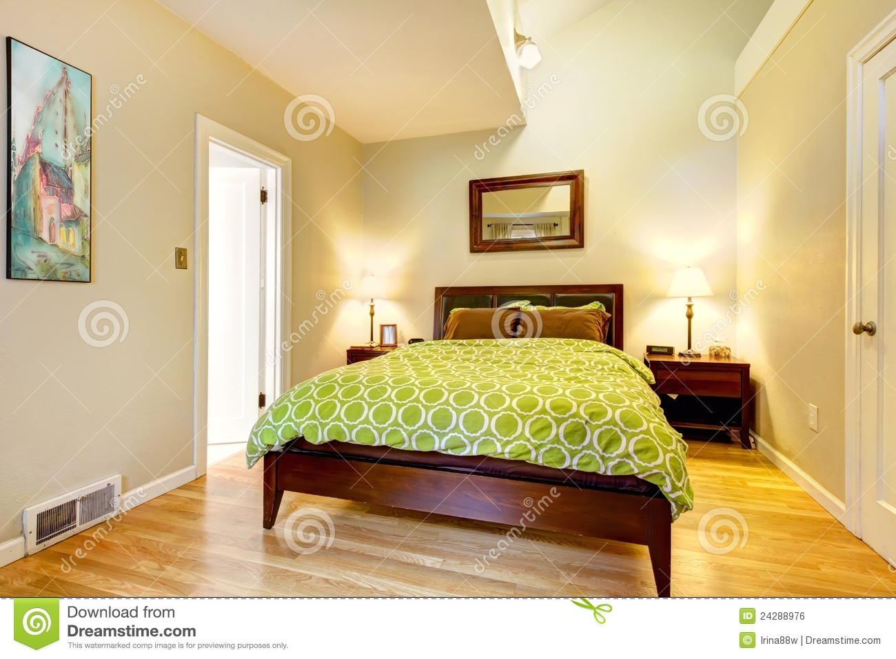 modern green and beige bedroom with brown bed. royalty free stock