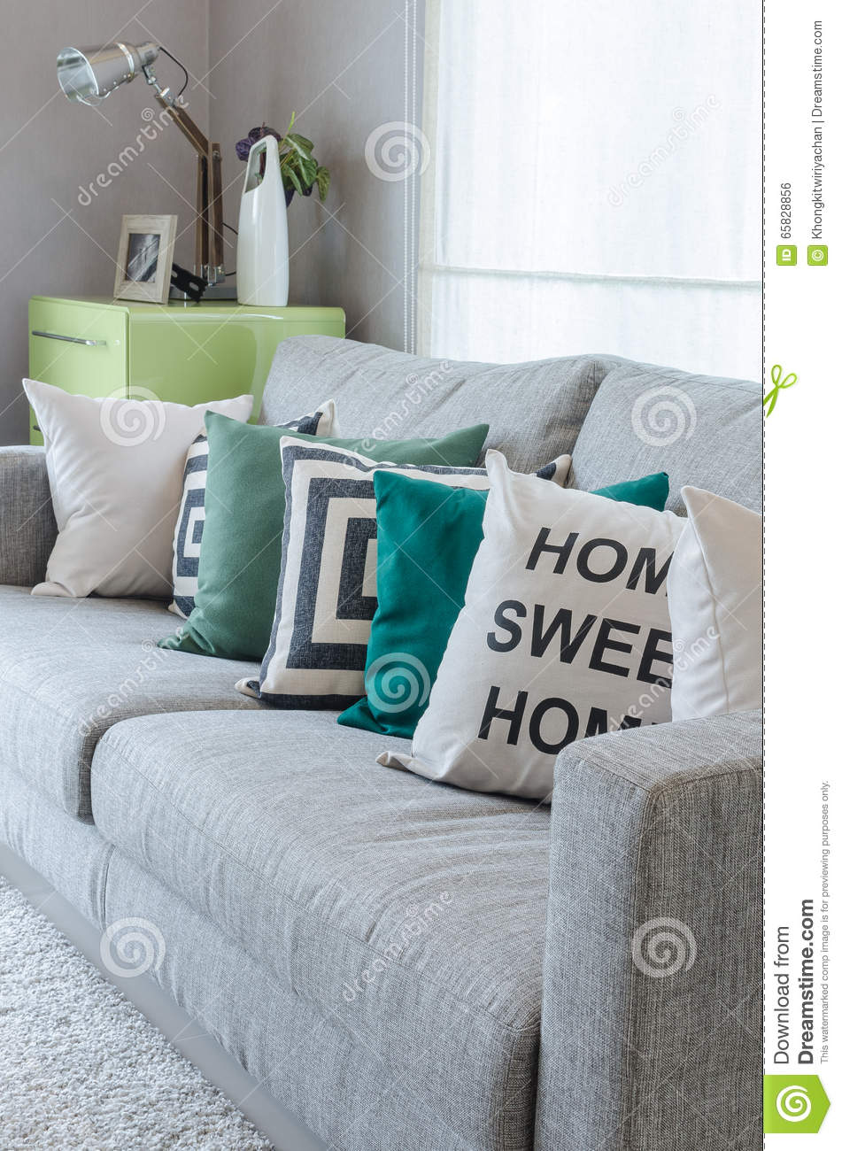 Modern Grey Sofa With Black And White And Green Pillows Stock