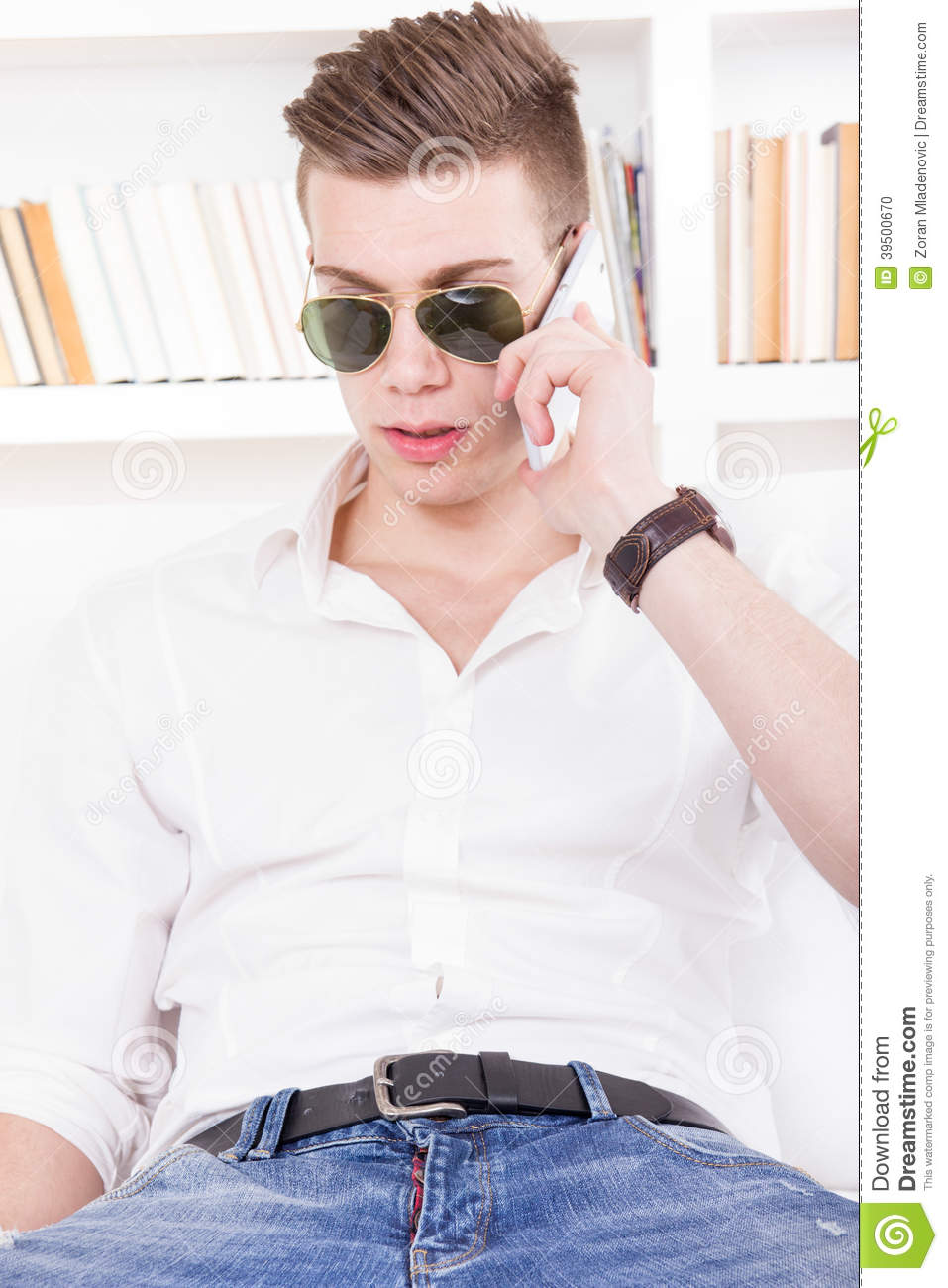 Modern guy with sunglasses talking on the phone