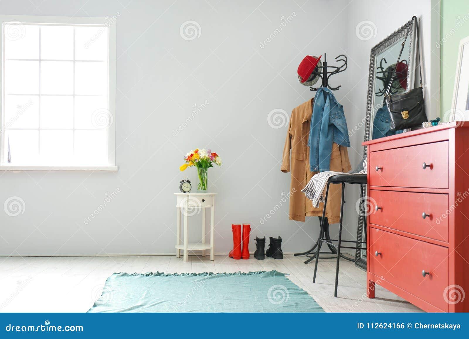 Modern hallway interior with clothes