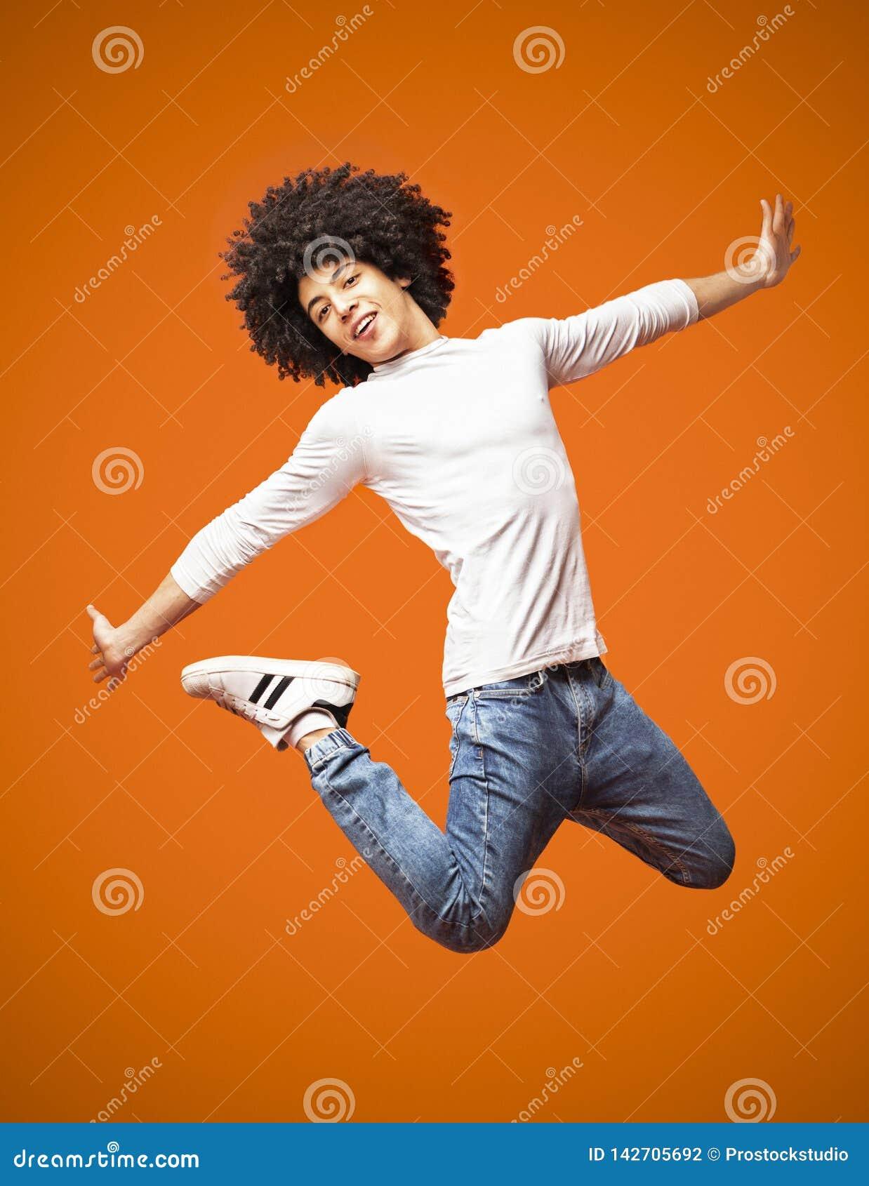 Modern Hip-hop Style Man Jumping On Orange Background ...