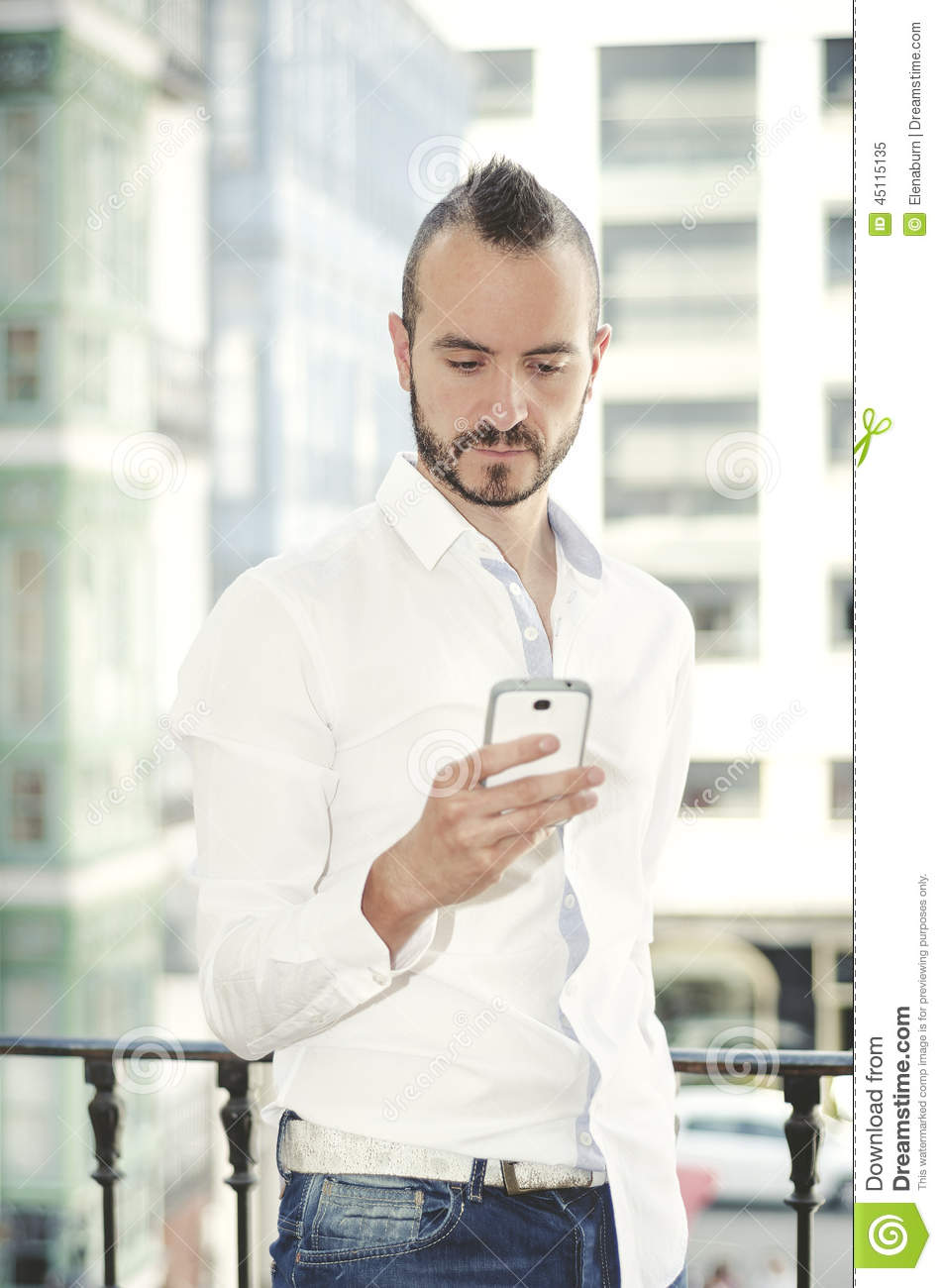Modern Hipster Man With Smart Phone, Outdoors Stock Photo ...