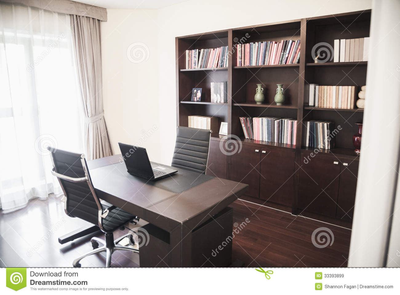 Modern Home Office With Bookshelves.