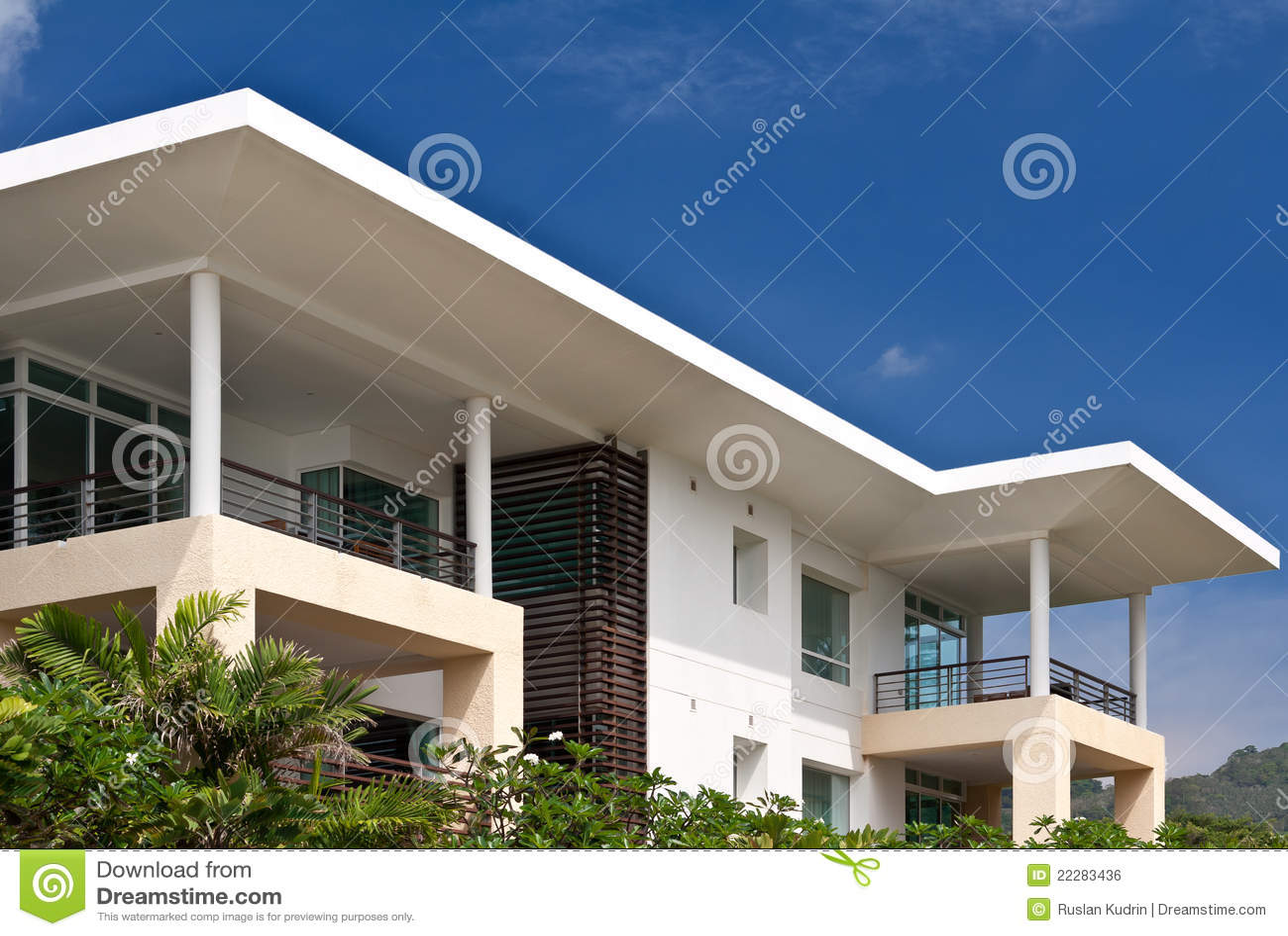 Modern house on a background of blue sky