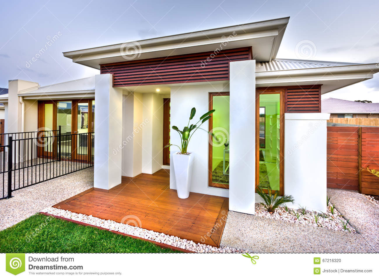 Modern House Entrance With A Wooden And Concrete Yard With A Law ...