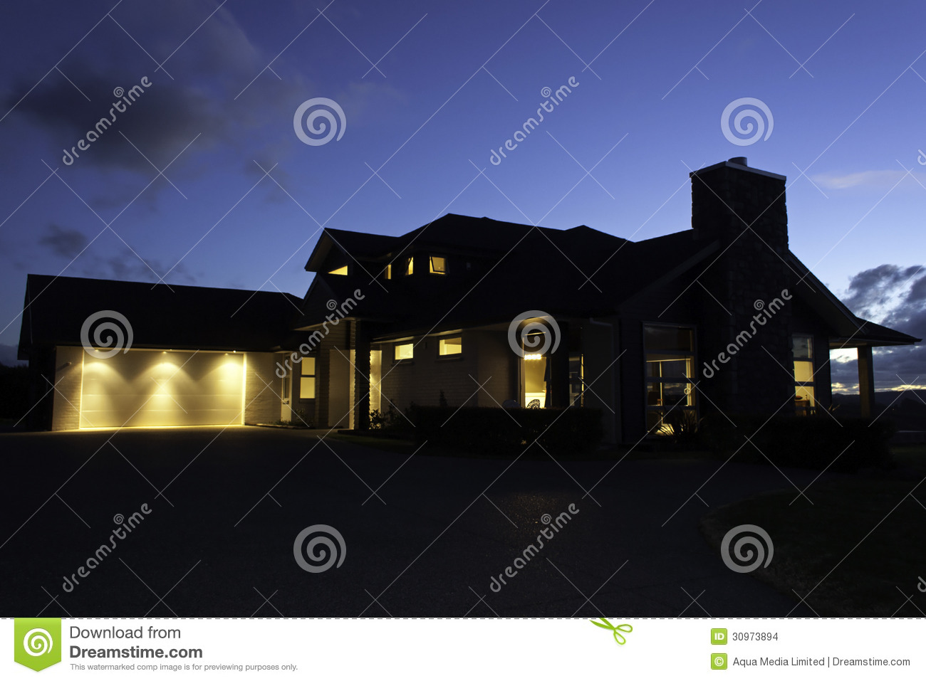 Modern house exterior with lighting at night stock images for Modern house at night