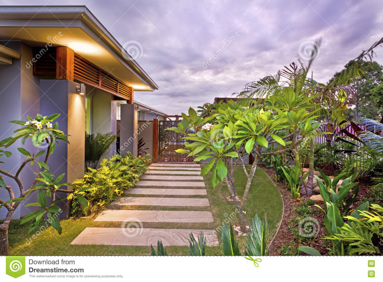Modern house garden with colorful illumination under the sky
