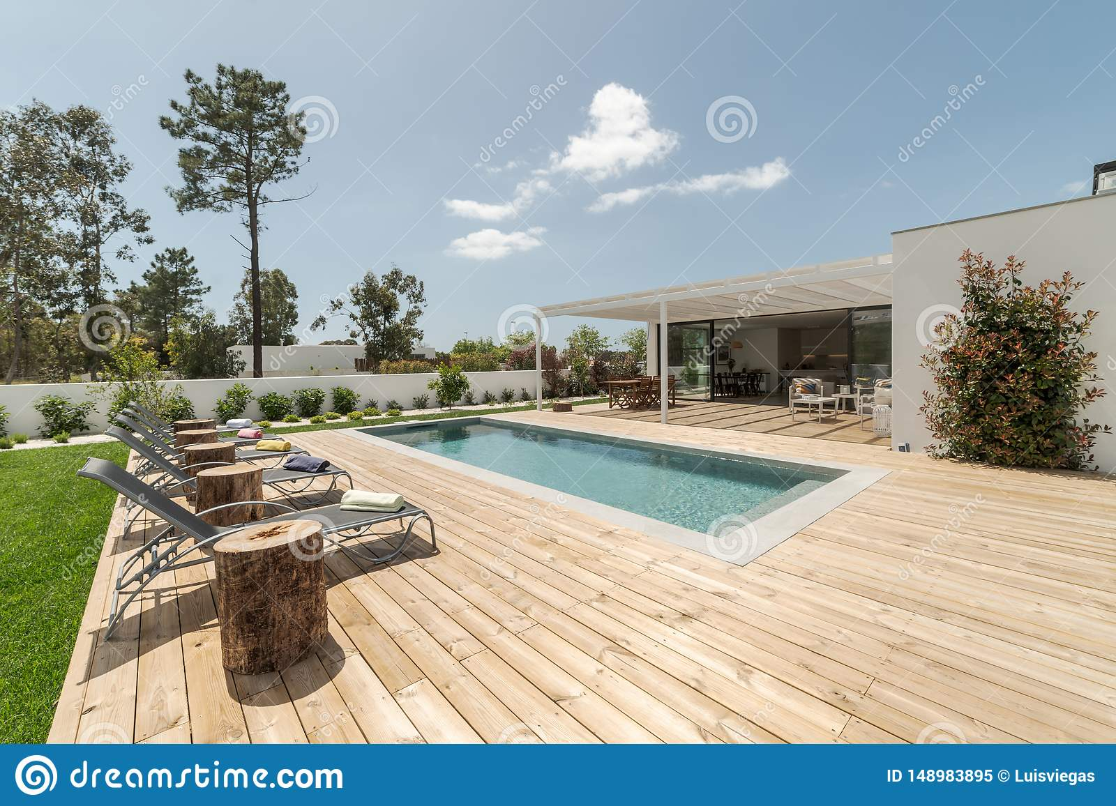 Modern House With Garden Swimming Pool And Wooden Deck Stock Image Image Of Garden Apartment 148983895