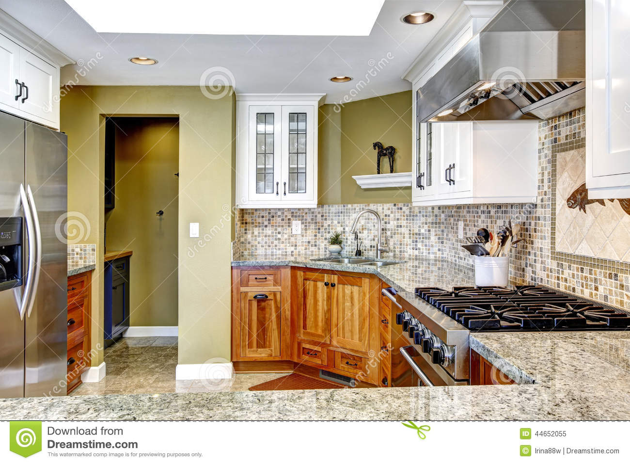 Modern house interior white and brown kitchen room with shiny granite tops and mosaic backsplash trim