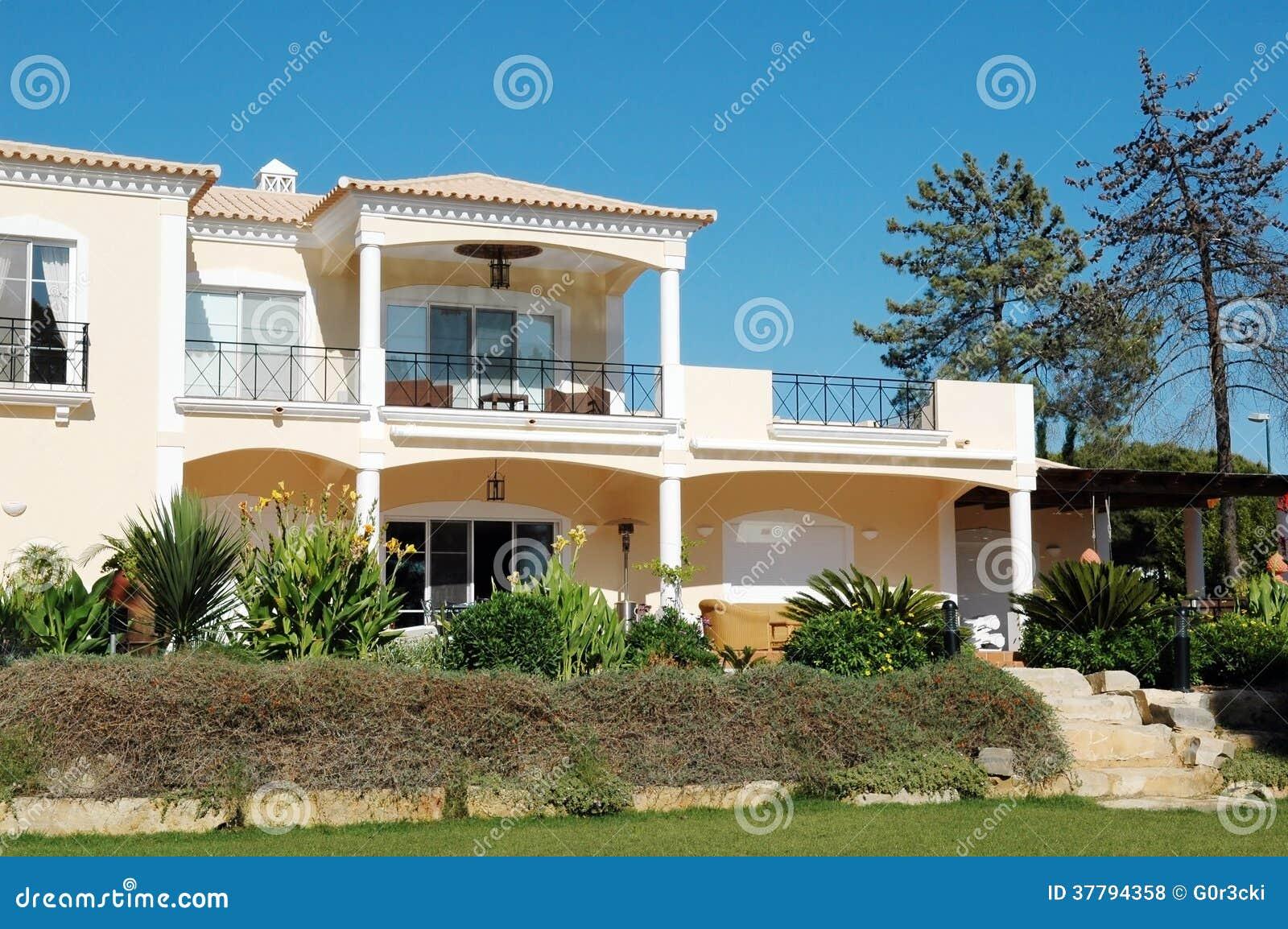 Modern Mansion With Rocky Backyard Garden Home Royalty