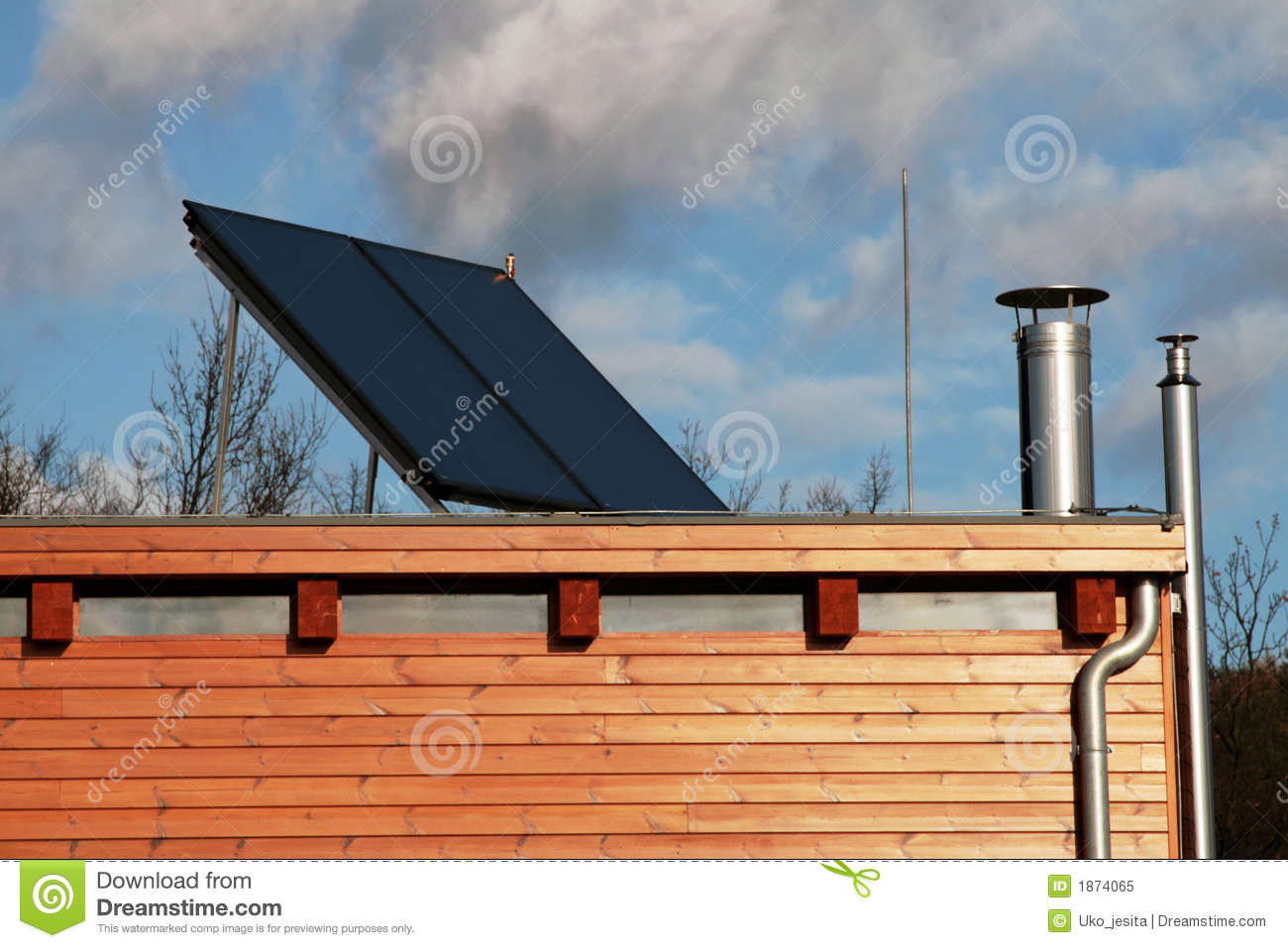 Modern House With Solar Panels On The Roof For Water