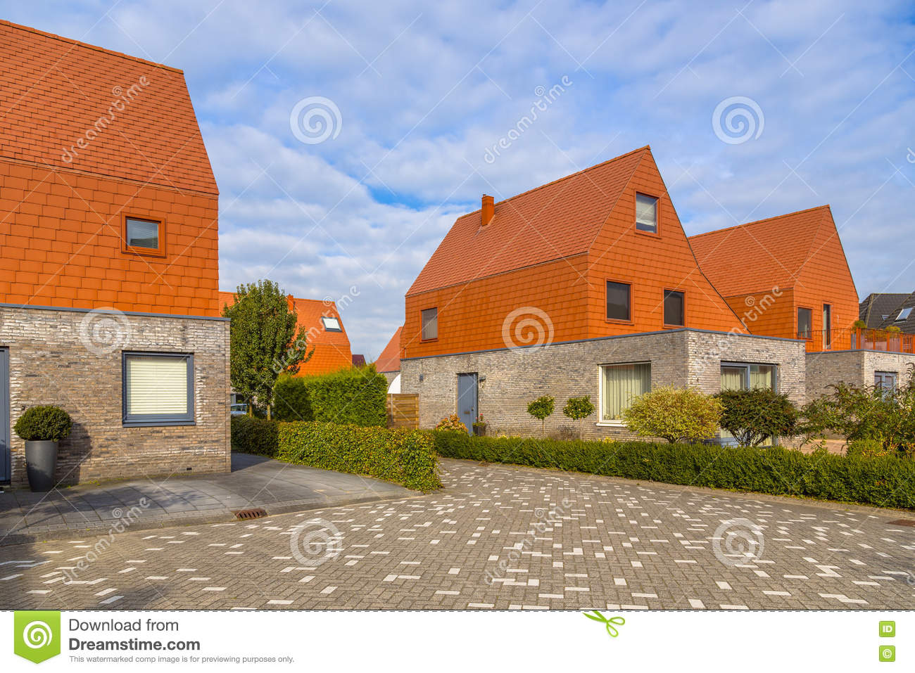 Modern Houses With Striking Red Slate Roof Tiles Stock