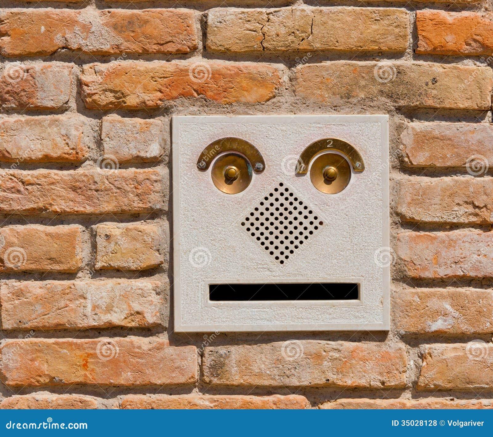 A Modern Intercom Doorbell Panel On Old Brick Wal Royalty