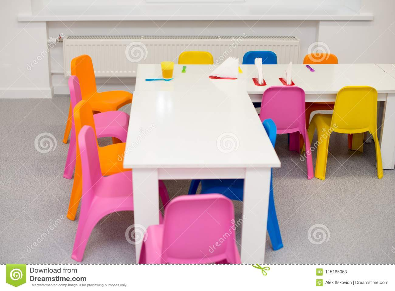 Modern interior of the children`s room in bright colors. shelves on