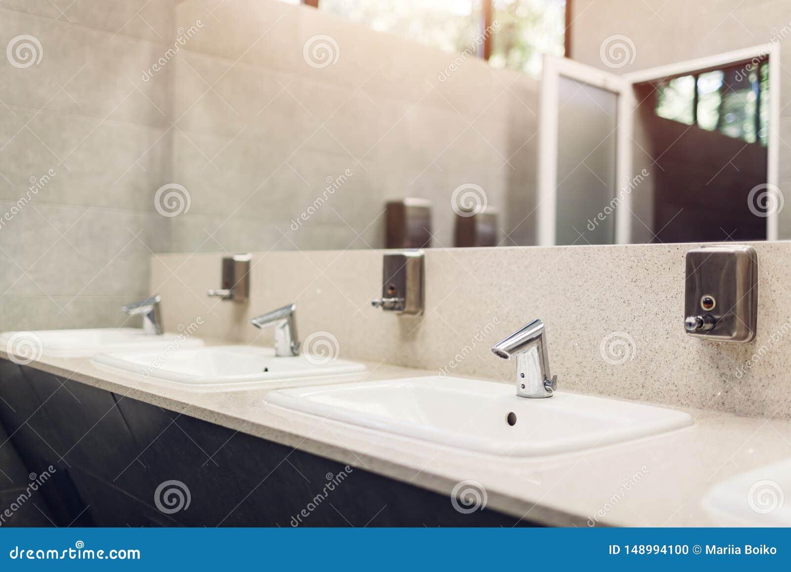 . Modern Interior Design In Public Toilet  New Sinks  Taps With Mirror