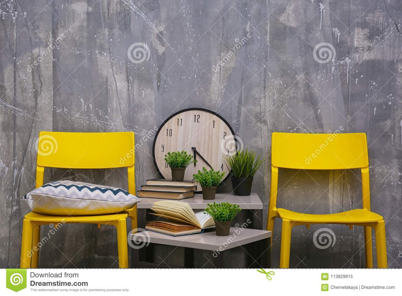 Modern Interior Design With Yellow Chairs And Little Table