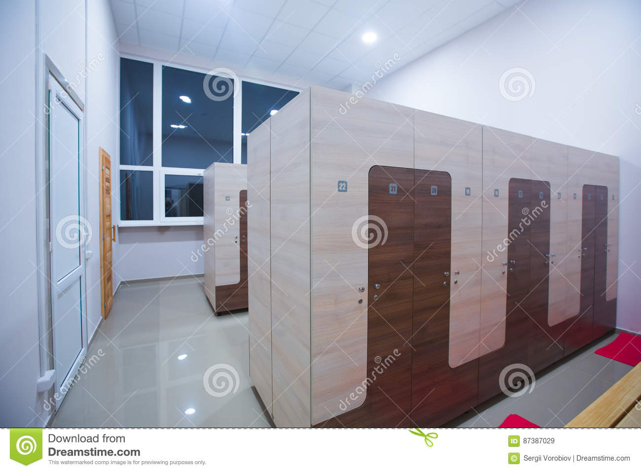Modern interior of a locker changing room in fitness center gym