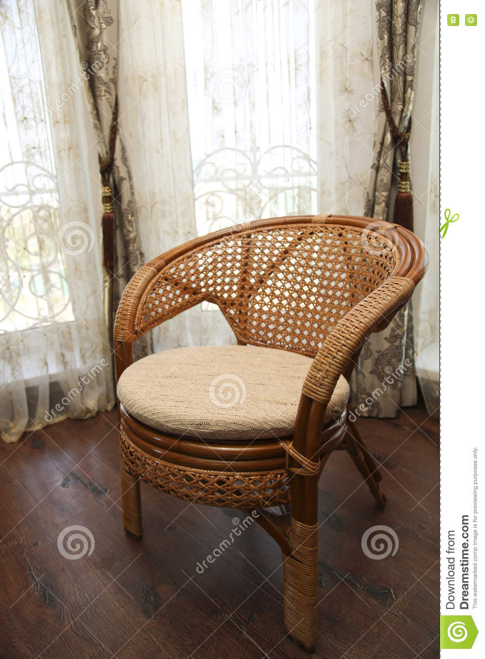 Modern interior with nice furniture inside wicker chair in the