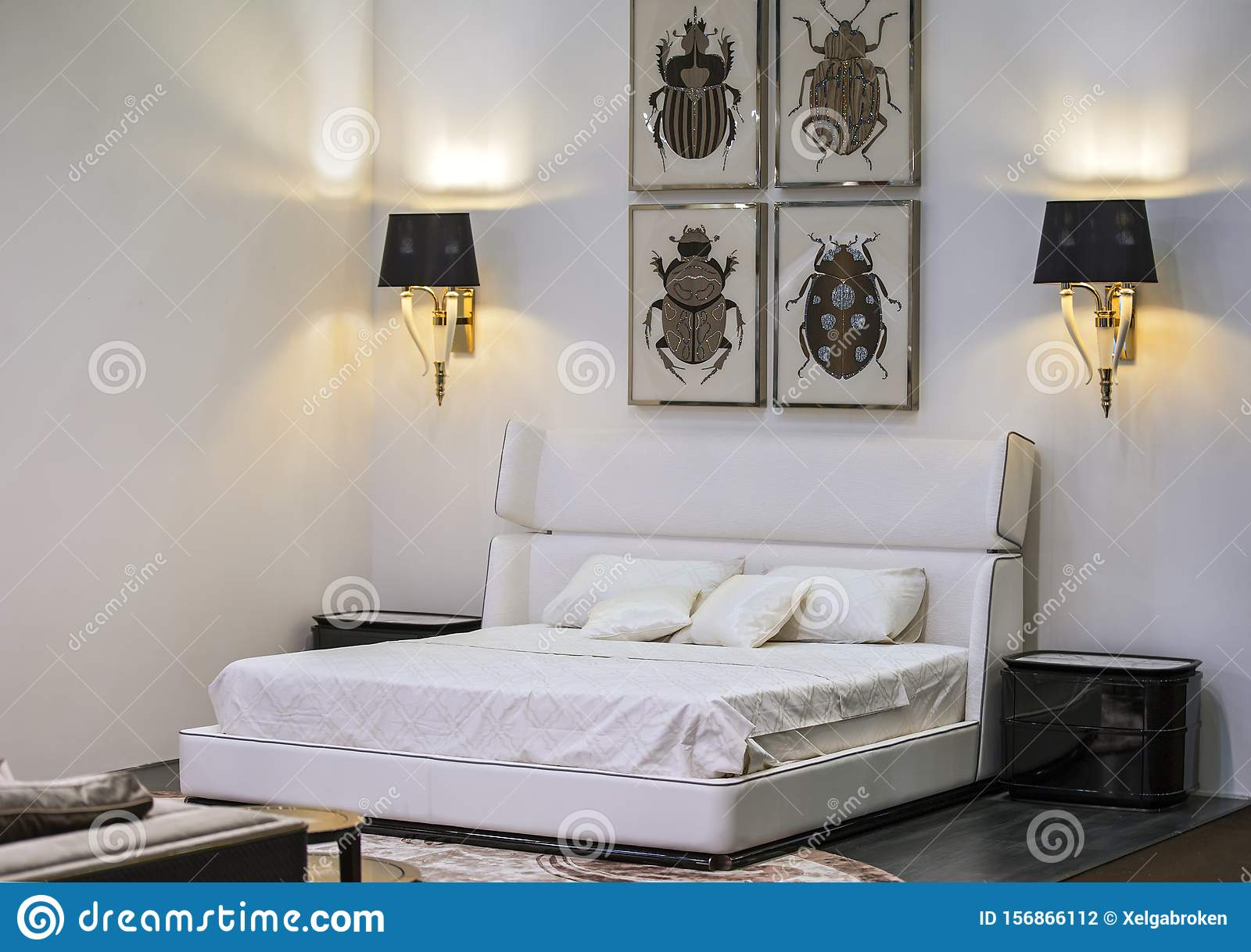 Modern Interior, White Bedroom With A Double Bed, Paintings ...