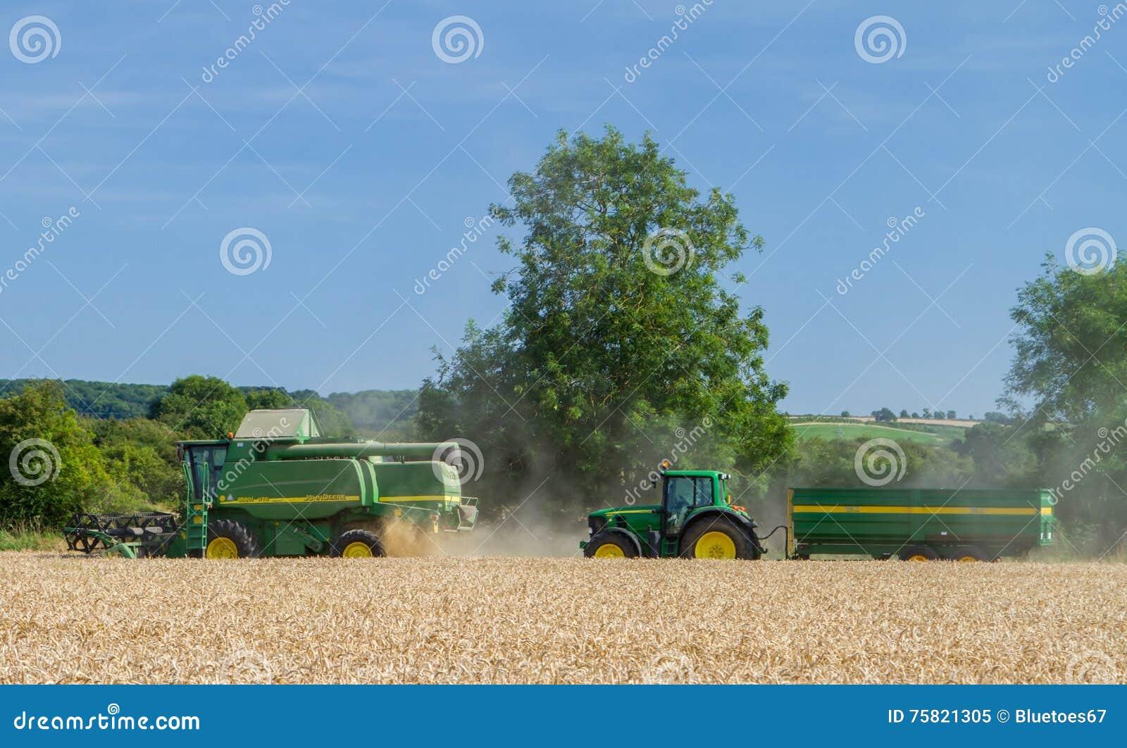 Cartoon Tractor Corn Picker : Modern john deere combine harvester cutting crops with