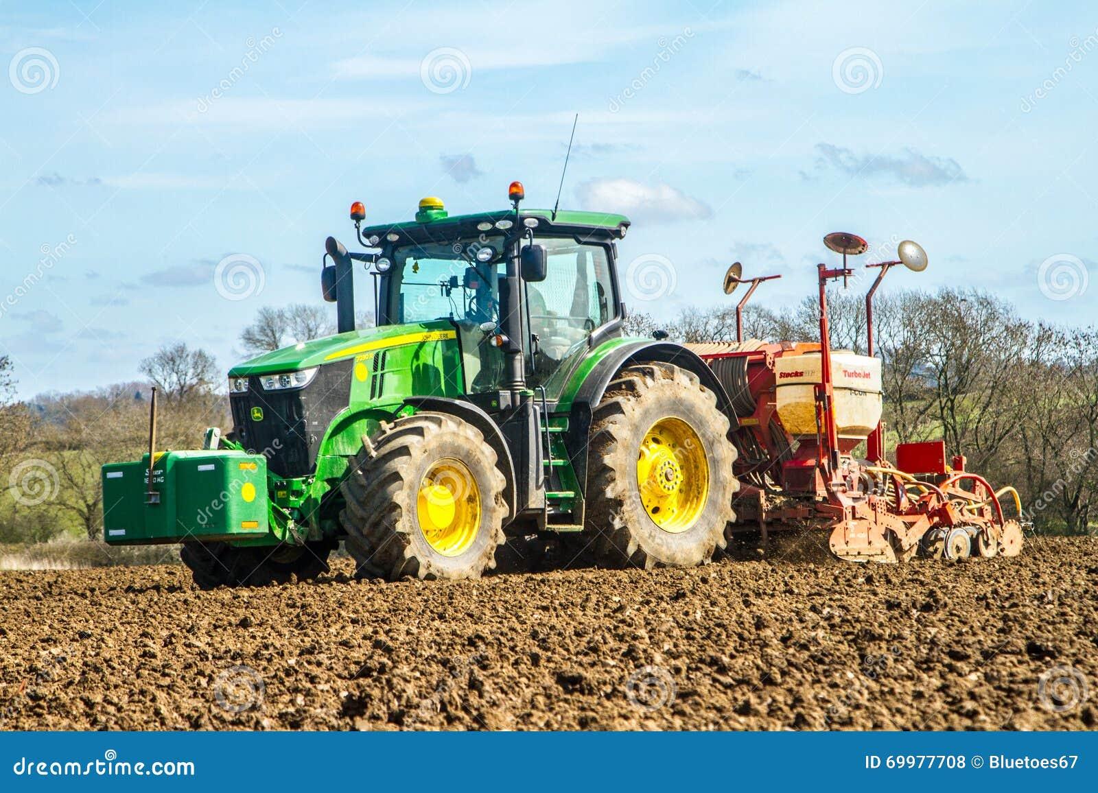 Tractor In Field Planting : Modern john deere tractor drilling seed in field editorial