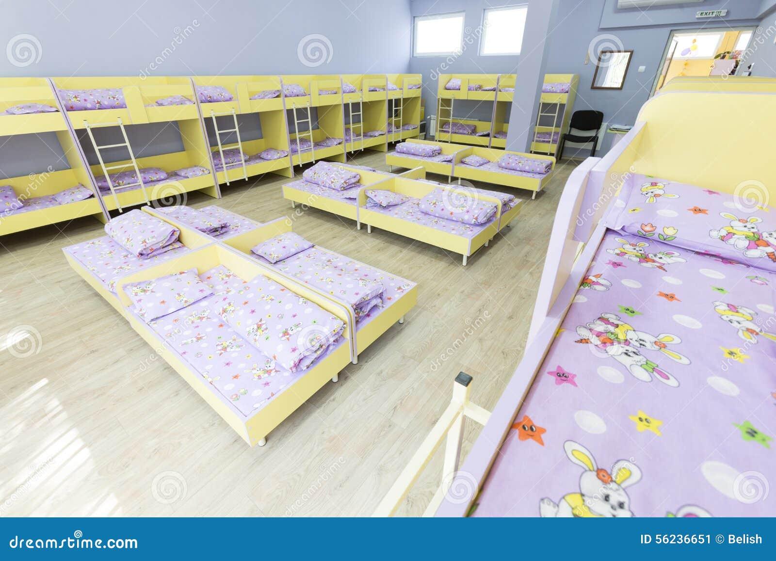 Modern Kindergarten Bedroom With Small Beds Stock Image