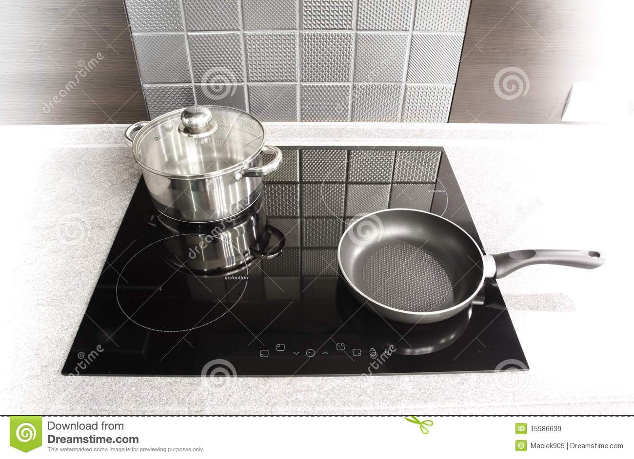 Modern Kitchen Appliances Pot And Pan On A Cooker Royalty