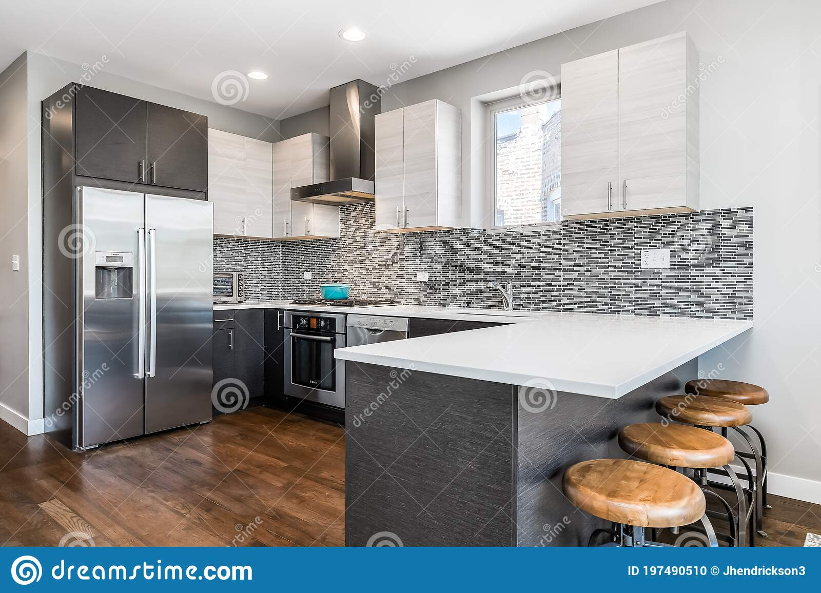 A Modern Kitchen With Bar Stools At The Counter Top. Editorial ...
