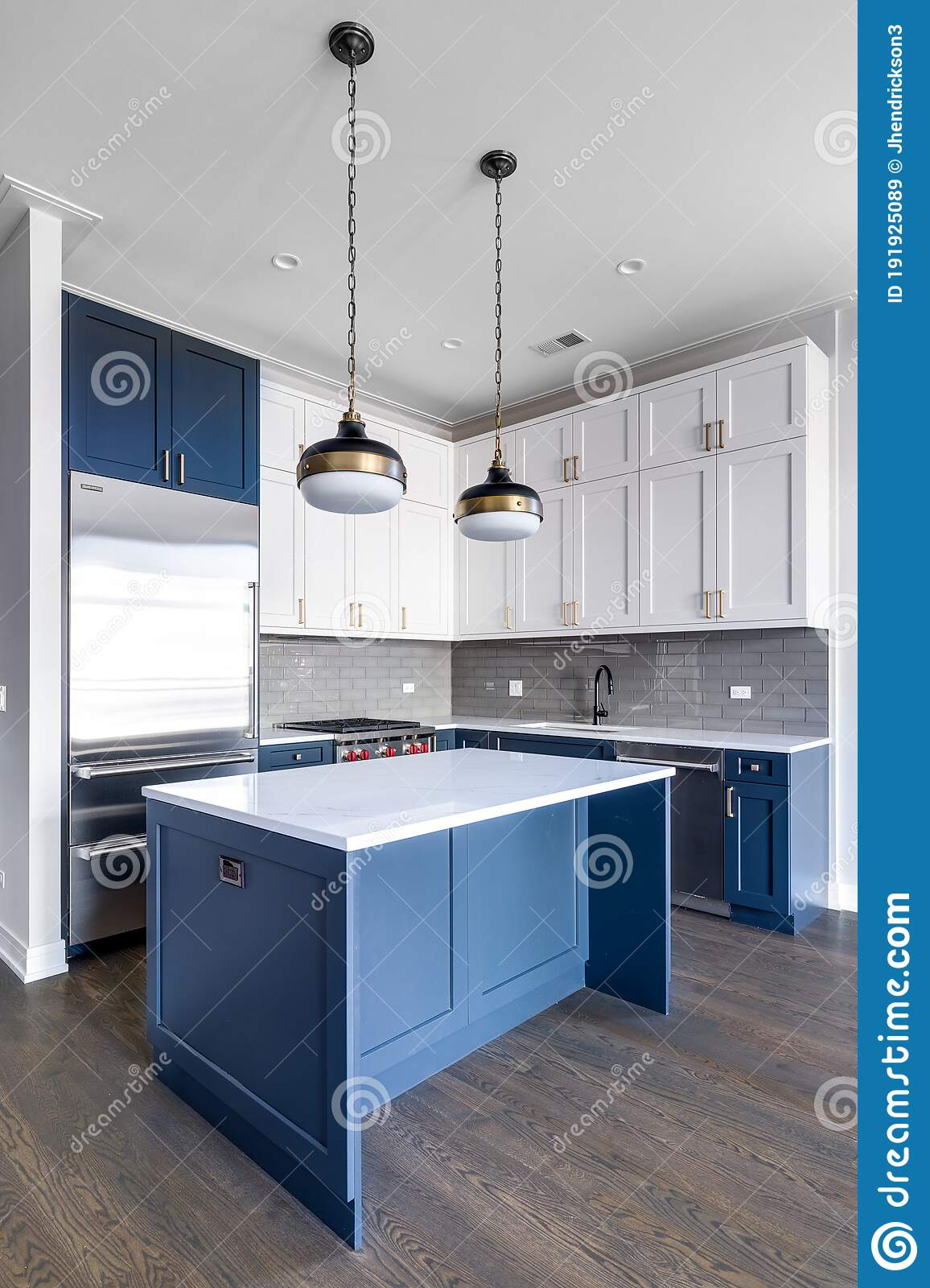 A Modern Kitchen With Blue And White Cabinets Editorial Stock Image Image Of Cabinet Estate 191925089