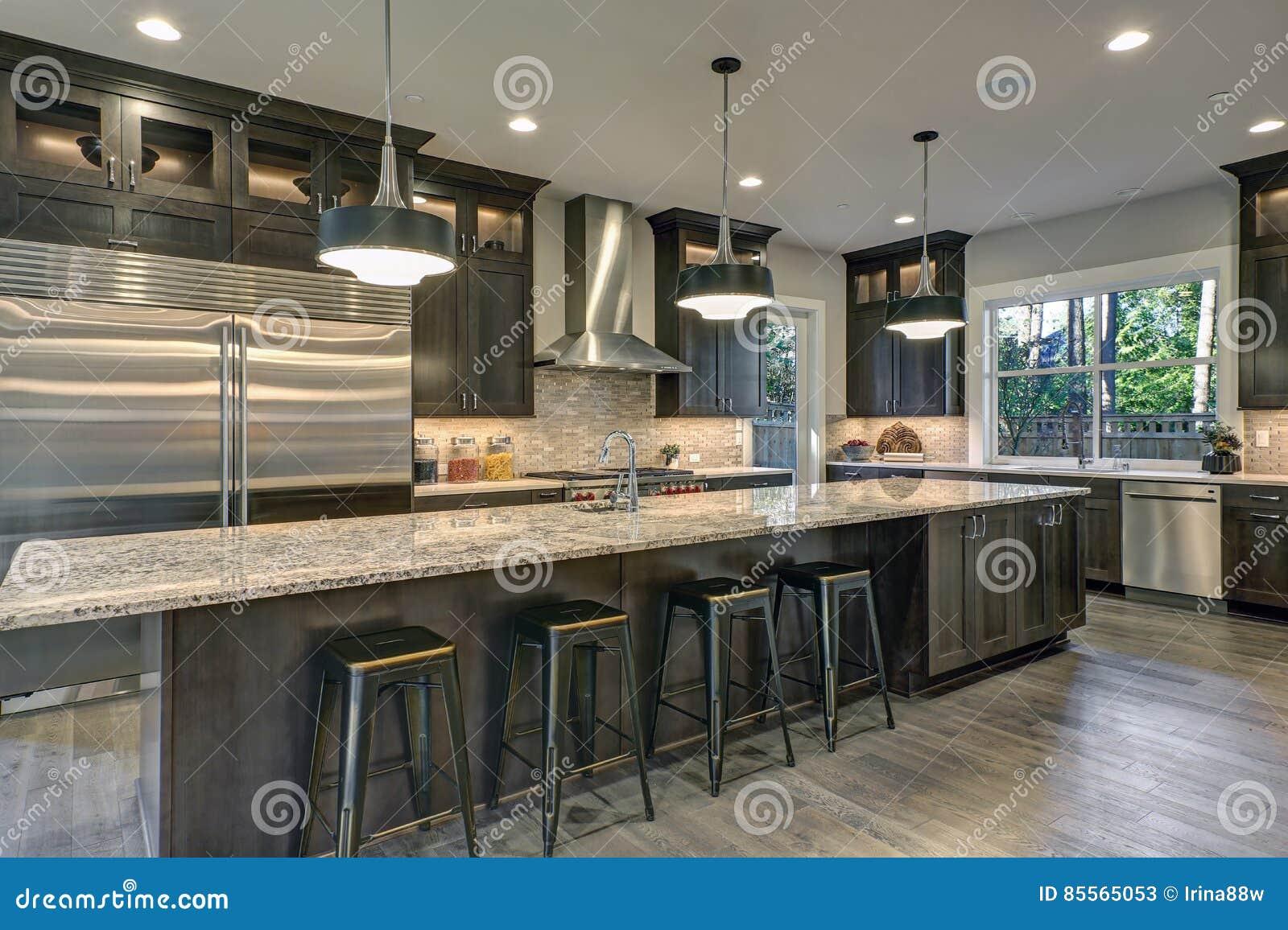 astonishing huge kitchen island   Modern Kitchen With Brown Kitchen Cabinets Stock Image ...