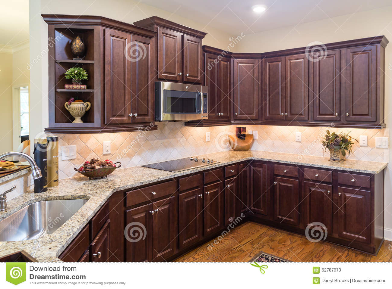modern kitchen with dark cabinets and wood floor stock image image of house granite 62787073. Black Bedroom Furniture Sets. Home Design Ideas