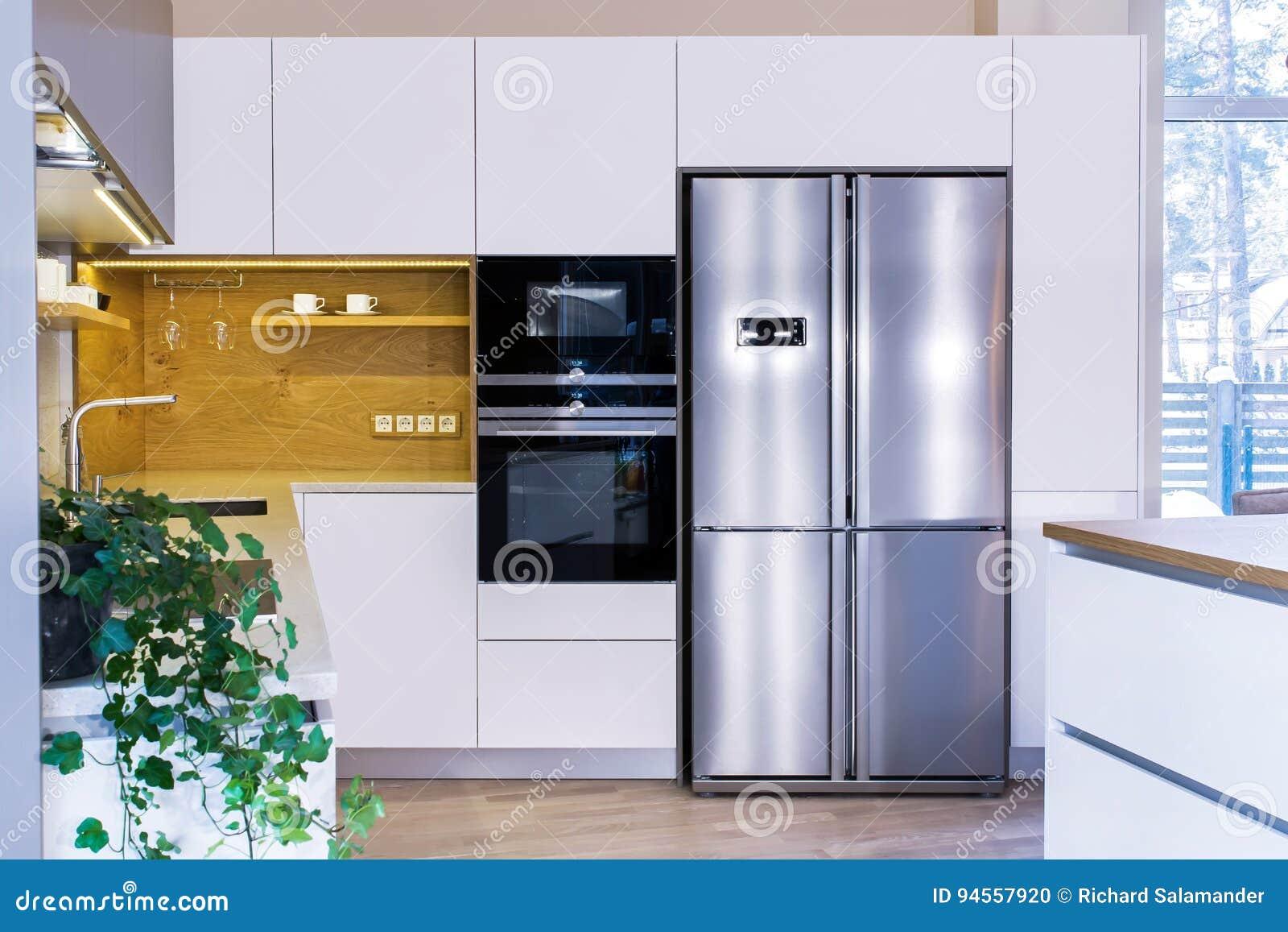 Modern kitchen design in light interior.