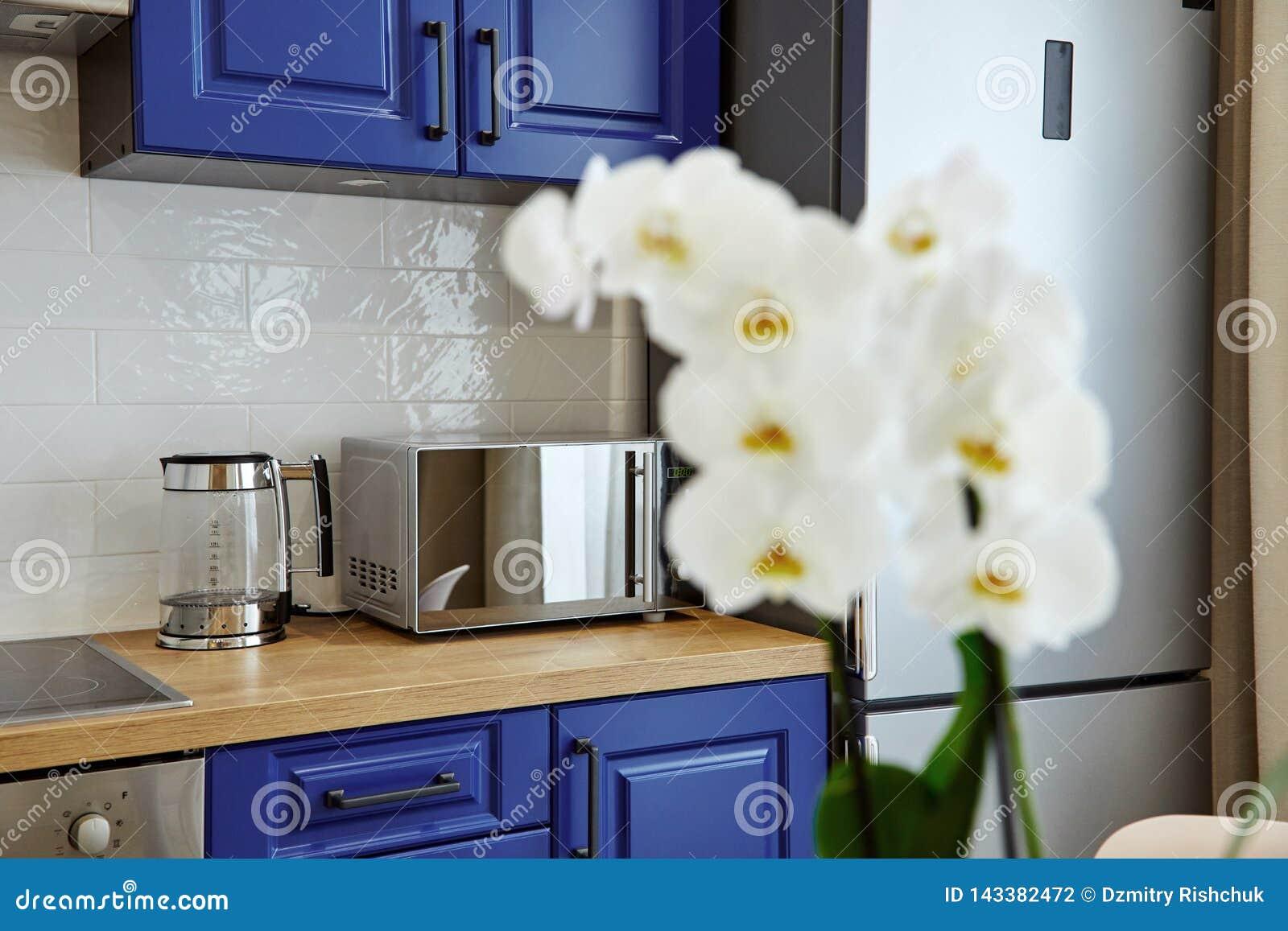 Modern kitchen with flowers. Home interior decor.