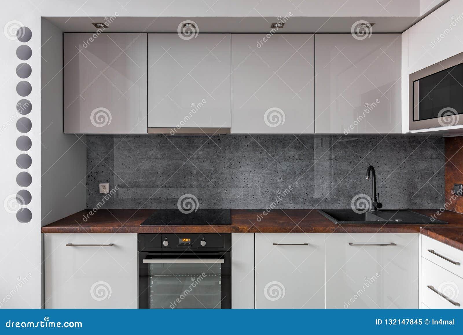 Modern Kitchen With Gray Backsplash Stock Image Image Of Granite Interior 132147845
